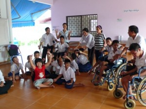 Disabled children gathered in a classroom
