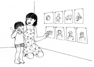 Child showing younger child simple images